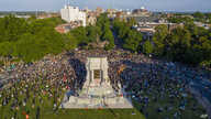 In this photo taken with a drone, a large group of protesters gather around the statue of Confederate General Robert E. Lee on Monument Avenue near downtown, June 2, 2020, in Richmond, Virginia.