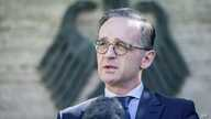 German Foreign Minister Heiko Maas addresses the media during a statement at the foreign ministry in Berlin, Germany, Wednesday, June 3, 2020. Germany's government says it plans to lift a travel warning for European countries on June 15.