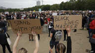 Protesters take part in a demonstration on Wednesday, June 3, 2020, in Hyde Park, London, over the death of George Floyd, a black man who died after being restrained by Minneapolis police officers on May 25.