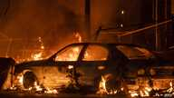 MINNEAPOLIS, MN - MAY 27: A car burns near the Third Police Precinct on May 27, 2020 in Minneapolis, Minnesota. A number of…