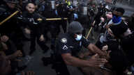 Police officers and protesters clash near CNN Center, Friday, May 29, 2020, in Atlanta, in response to George Floyd's death in…