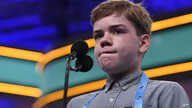 Anson Cook, 12, of Potomac, Md., reacts as he tries to spell his word as he competes in the finals of the Scripps National…