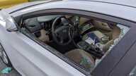 This Thursday, May 21, 2020, photo shows a parked car with a broken driver's side window after a smash-and-grab break-in in Los…