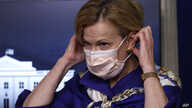 Dr. Deborah Birx, White House coronavirus response coordinator, puts on a face mask after speaking with reporters about the…