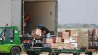 Workers unload a cargo plane carrying medical aid at the Baghdad Airport in Iraq, Monday, April 20, 2020. Medical aid from the…
