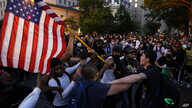 Demonstrators clash as people gather to protest the death of George Floyd, Saturday, May 30, 2020, near the White House in…