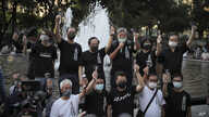 Activists chant slogans during a gathering to mourn those killed in the 1989 Tiananmen crackdown at Victoria Park in Causeway…