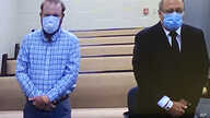 In this image made from video, Travis McMichael, left, and Greg McMichael listen to a preliminary hearing via a court video…