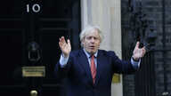 "Britain's Prime Minister Boris Johnson applauds on the doorstep of 10 Downing Street in London during the weekly ""Clap for our…"