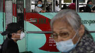 People ride a bus during the first day of a more relaxed lockdown that was placed to prevent the spread of the new coronavirus…