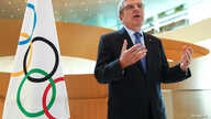 Thomas Bach, President of the International Olympic Committee (IOC) attends an interview after the decision to postpone the…