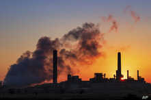 FILE -  the Dave Johnson coal-fired power plant is silhouetted against the morning sun in Glenrock, Wyo.