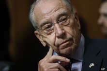 FILE - Senate Judiciary Committee Chairman Chuck Grassley of Iowa chairs a meeting of the committee on Capitol Hill in Washington, Sept, 28, 2018.