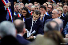 """French President Emmanuel Macron attends a meeting with mayors from rural Normandy as part of the launching of the """"Great National Debate"""" designed to find ways to calm social unrest in the country, in Grand Bourgtheroulde, France, Jan. 15, 2019."""