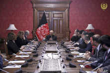 In this photo released by the Afghan Presidential Palace, Afghan President Ashraf Ghani, center, speaks to U.S. peace envoy Zalmay Khalilzad, third left, at the presidential palace in Kabul, Afghanistan, Jan. 28, 2019.