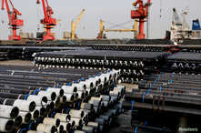 Steel pipes to be exported are seen at a port in Lianyungang, Jiangsu province, China, Dec. 8, 2018.