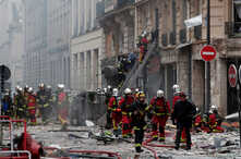 Firemen work at the site of an explosion in a bakery shop in the 9th District in Paris, Jan. 12, 2019.