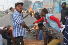 Protesters construct a burning roadblock in Kinshasa, Congo, Monday Jan. 21, 2019. Congo's police dispersed a gathering Monday of supporters waiting to hear a speech by presidential runner-up Martin Fayulu, his spokeswoman said.