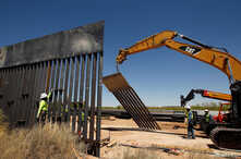 Construction workers are seen next to heavy machinery while working on new bollard wall in Santa Teresa, New Mexico, as seen from the Mexican side of the border in San Jeronimo, on the outskirts of Ciudad Juarez, Mexico, April 23, 2018.