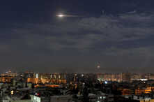 In this photo released by the Syrian official news agency SANA, shows missiles flying into the sky near international airport, in Damascus, Syria, Jan. 21, 2019