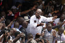 Defeated Congo opposition candidate Martin Fayulu greets supporters as he arrives at a rally in Kinshasha, Congo, Jan. 11, 2019.