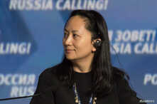 """Meng Wanzhou, Executive Board Director of the Chinese technology giant Huawei, attends a session of the VTB Capital Investment Forum """"Russia Calling!"""" in Moscow, Oct. 2, 2014."""