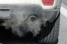 FILE - Exhaust comes from the tailpipe of a vehicle, Jan. 3, 2019, in Salt Lake City, Utah.