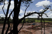 Firefighters search for bodies days after a dam collapse in Brumadinho, Brazil, Jan. 28, 2019.
