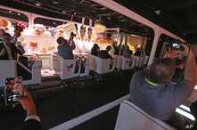 The Google Assistant ride shows off the new features in its voice-enabled digital assistant as visitors ride along at the Google display area at CES International Tuesday, Jan. 8, 2019, in Las Vegas.