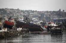 FILE - Boats lifted by an earthquake-triggered tsunami sit on a dock, in Coquimbo, Chile, Sept. 18, 2015. A magnitude 6.7 quake struck the city Jan. 19, 2018, but no tsunami was generated.