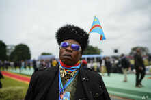 Supporters of Congolese President elect Felix Tshisekedi gather at the Palais de la Nation for his inauguration in Kinshasa, Democratic Republic of the Congo, Thursday Jan. 24, 2019.