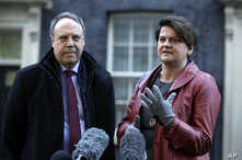 DUP Party leader Arlene Foster and Deputy Leader Nigel Dodds, left, make a statement to the media after exiting 10 Downing Street. London, Jan. 17, 2019.