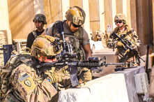 A handout picture received from the US embassy in Iraq on December 31, 2019, shows American soldiers taking position around the…