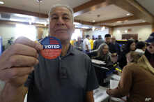 Frank Salazar, 70, shows an 'I voted' sticker after casting his ballot on the Super Tuesday, at a voting center in Alhambra