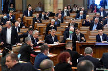 Hungarian Prime Minister Viktor Orban votes the law granting the government special powers to combat the coronavirus disease …