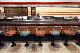 FILE - The lunch counter at the former F.W. Woolworth is shown at the International Civil Rights Center and Museum in Greensboro, N.C.
