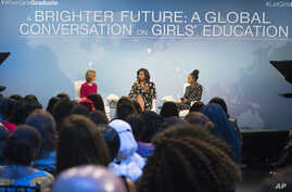 """First lady Michelle Obama, flanked by actress Yara Shahidi (R) and Glamour Magazine Editor in Chief  Cindi Leive, participates in Glamour's """"A Brighter Future: A Global Conversation on Girls' Education,"""" in celebration of International Day of the Gir"""