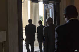 Members of the House of Representatives begin to head for the door on Capitol Hill in Washington, July 31, 2014, as Congress leaves for a five-week summer recess.