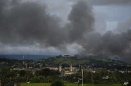 Black smoke from continuing military air strikes rises above a mosque in Marawi city, southern Philippines, June 9, 2017. Nearly every day for the past three weeks, the Philippine military has pounded the lakeside town of Marawi as it tries to wipe o