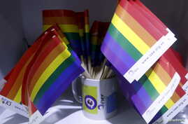 FILE - Gay rainbow flags are seen at social research institute during a meeting of gays in Hanoi, Vietnam, Nov. 26, 2015.