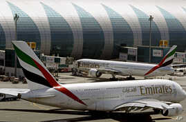 FILE - Emirates passenger planes are seen at Dubai airport in United Arab Emirates,  May 8, 2014.