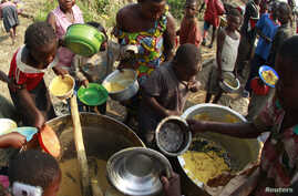Congolese refugees, displaced by fighting between the Congo army and rebel group Allied Democratic Forces (ADF) last week, gather to collect food at the Bukanga transit camp in Bundibugyo town camp, 376km (238 miles) southwest of Kampala, July 17, 20...