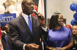 Andrew Gillum and his wife, R. Jai Gillum addresses his supporters after Andrew Gillum won the Democratic primary for governor, Aug. 28, 2018, in Tallahassee, Florida.