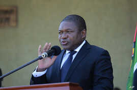 Mozambique President Filipe Nyusi delivers a speech during the state funeral of Mozambique's opposition leader, Alfonso Dhlakama, in Beira, May, 9, 2018. Starting soon, journalists covering Nyusi and Mozambique will be expected to pay what may be the