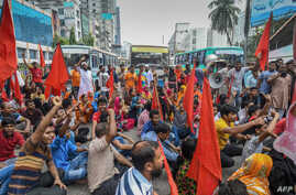 Bangladeshi garment workers and their supporters hold a rally in Dhaka, Sept. 14, 2018, to demand a higher monthly minimum wage.