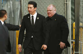 "Embattled Toronto Mayor Rob Ford (R) arrives for an appearance on the ""Jimmy Kimmel Live!"" show in Hollywood, California, March 3, 2014."