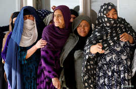 Afghan women line up to cast their votes during a parliamentary election at a polling station in Kabul, Afghanistan, Oct. 21, 2018.