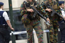 FILE - Belgian Army soldiers patrol during a court hearing for suspect Mohamed Abrini, a suspect in the Paris and Brussels attacks, that were claimed by the Islamic State organization, at the Court of Appeals in Brussels.