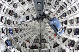 Volkswagen cars are presented to media inside a delivery tower prior to the company's annual press conference in Wolfburg, Germany, April 28, 2016.