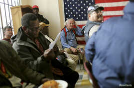 A group of veterans await a clothing giveaway at St. Anthony Foundation in San Francisco, California November 8, 2013. Homeless and low-income veterans receive free clothing such as suits, dress shirts, belts and shoes ahead of the U.S observance of